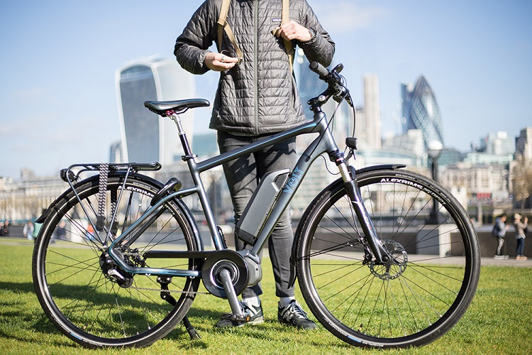 Man Standing Next To Ebike